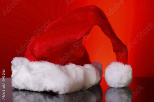 father christmas hat on reflective surface