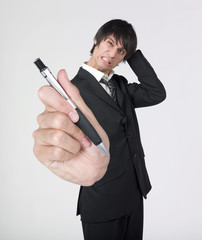 worried businessman giving a pen