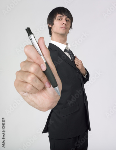 businessman giving a pen