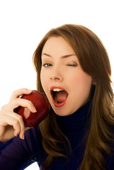 beautiful woman eats and apple and winks