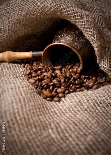 Papiers peints Café en grains Cezve with freshly roasted coffee beans on sackcloth