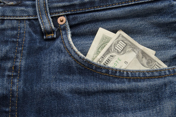 100 dollar bill sticking out from a old jean pocket
