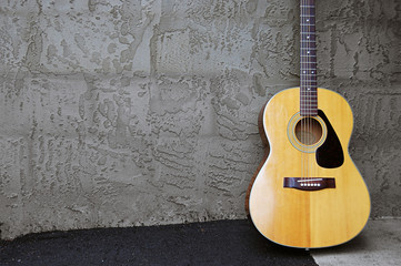 Acoustic Guitar on Block Wall