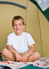 Boy sitting in tent