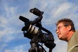 Cameraman shooting video poster