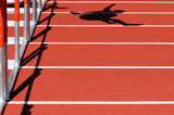 Shadow of a person jumping over the hurdles poster