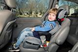 Preschool age boy in a booster seat