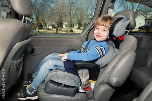 Preschool age boy in a booster seat