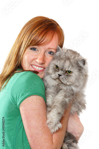 Smiling teenager holding her cat