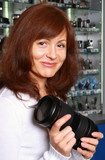 The girl-seller of phototechnics holds the big objective