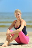 Sporty blond female on the beach poster