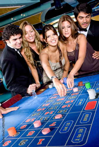 friends gambling in a casino