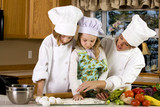 Mother teaching children how to cook poster