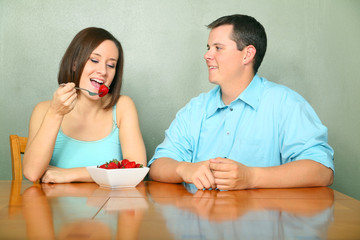 Caucasian Couple Talking On Kitchen Table
