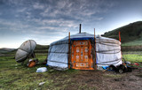 Mongolian dwelling on the green plain of grass poster