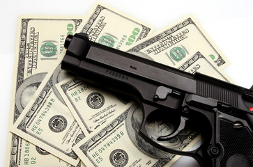pistol and dollar