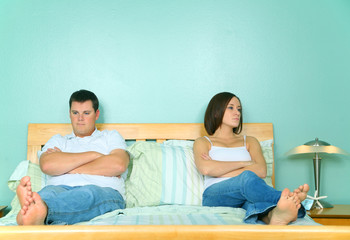 Upset Caucasian Couple Not Getting Along In Bed