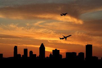 Planes departing Montreal at sunset