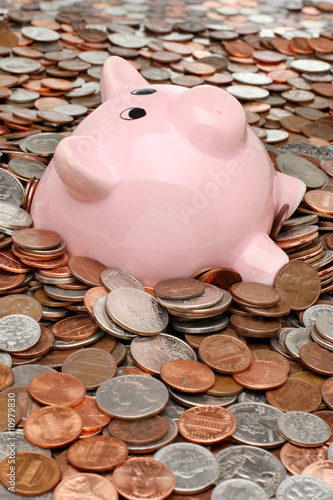 Piggy bank drowning in a sea of coins