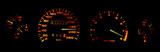 Car dashboard gauges in the dark