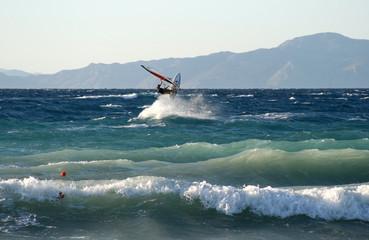 Jumping windsurfer