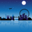 London skyline silhouette at night with reflection on thames