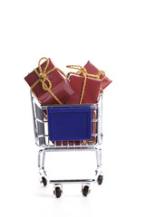 shopping cart full with christmas present box