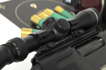 Shotgun with a rifle scope target and shotshell