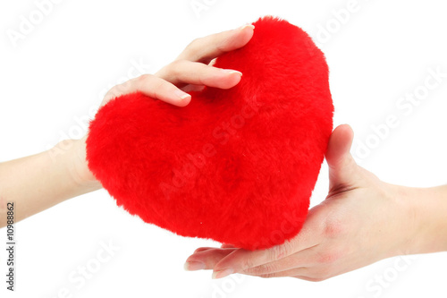 Close-up of red wooden heart in female hands
