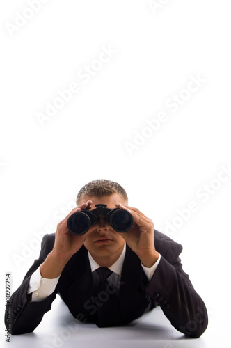 smart young lawyer using a pair of binoculars