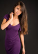 Beautiful Brunette Lady Posing in a Purple Dress