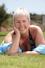beautiful mature woman relaxing outdoors