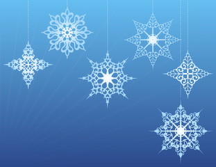 Snowflake Ornaments on a Blue Background