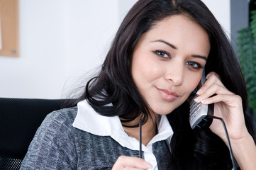 Female Worker on the phone.