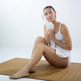 Relaxed woman with white towel poster