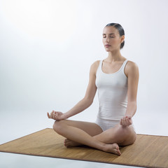 woman making yoga exercises