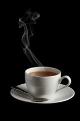 cup of hot tea with steam isolated over black