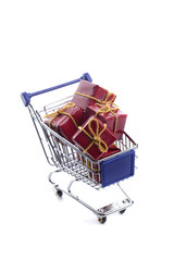 shopping cart full with red christmas present box