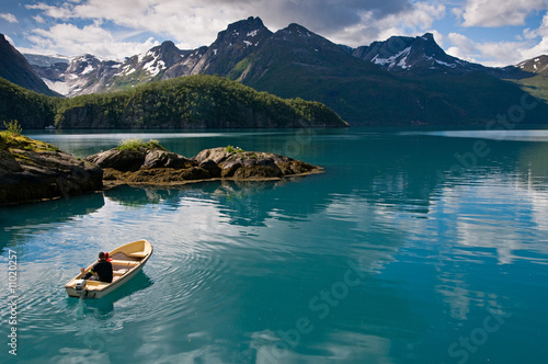 Small boat on fjord - 11020257