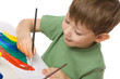 boy draws with paints