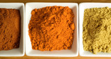 Colorful spices in square dishes