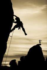 Rock climber silhouetted.