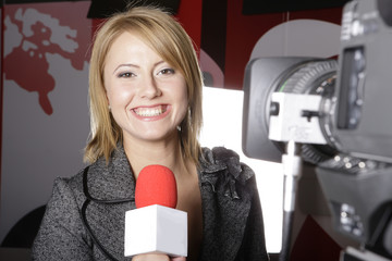 live televizion transmission and smiling reporter