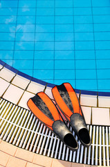Scuba on the edge of outdoor pool
