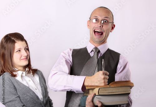 Mad teacher holding books and  screaming