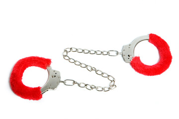 handcuffs with red fur isolated on white