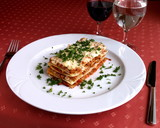 Dish of Italian cuisine - lasagna with greenery poster