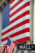 Wall Street, street sign, with US flag
