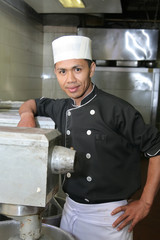 chef with mixer machine in pastry