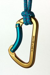 Blue and gold karabiner hanging from a rope